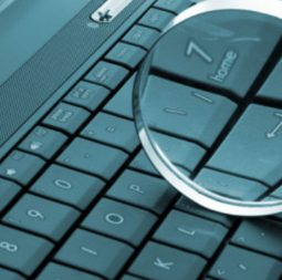 magnifying-glass-on-blue-computer